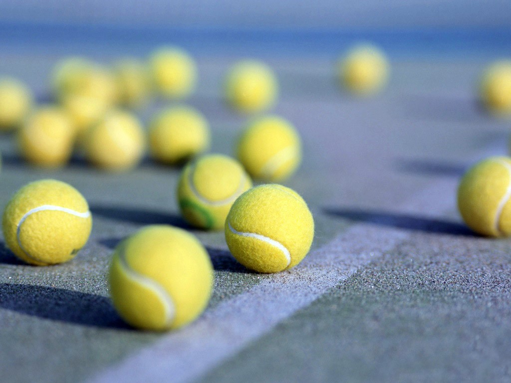 playing tennis at belcekiz beach club
